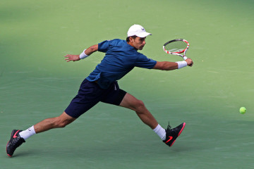 SHANGHAI, CHINA - OCTOBER 07: Santiago Giraldo of Columbia returns a shot during his match against Vasek Pospisil of Canada during the day 3 of the Shanghai Rolex Masters at the Qi Zhong Tennis Center on October 7, 2014 in Shanghai, China. (Photo by Zhong Zhi/Getty Images)
