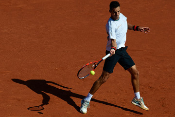 BARCELONA, SPAIN - APRIL 23:  Santiago Giraldo of Colombia in action against Kei Nishikori of Japan during day four of the Barcelona Open Bac Sabadell at the Real Club de Tenis Barcelona on April 23, 2015 in Barcelona, Spain.  (Photo by Manuel Queimadelos Alonso/Getty Images)